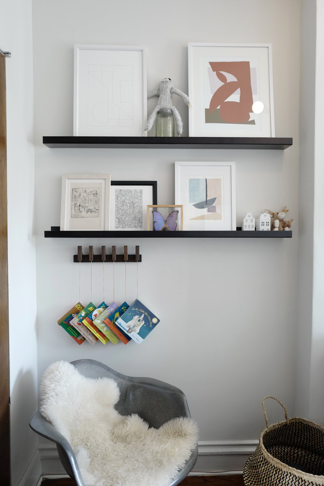 Kids Room, Toddler Age, Shelves, Bedroom Room Type, Chair, Pre-Teen Age, Neutral Gender, and Storage  Photo 15 of 16 in A Design Duo's 19th-Century Brooklyn Townhouse Is Filled With Art They Love