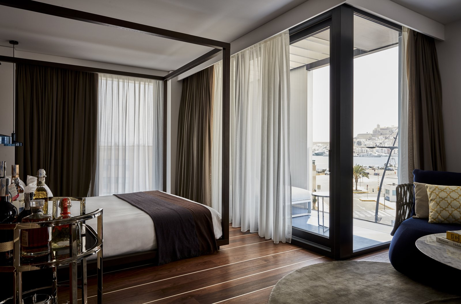 Bedroom, Bed, and Dark Hardwood Floor  Photo 5 of 11 in A New Hotel That Celebrates Ibiza's Maritime History and Love For Parties