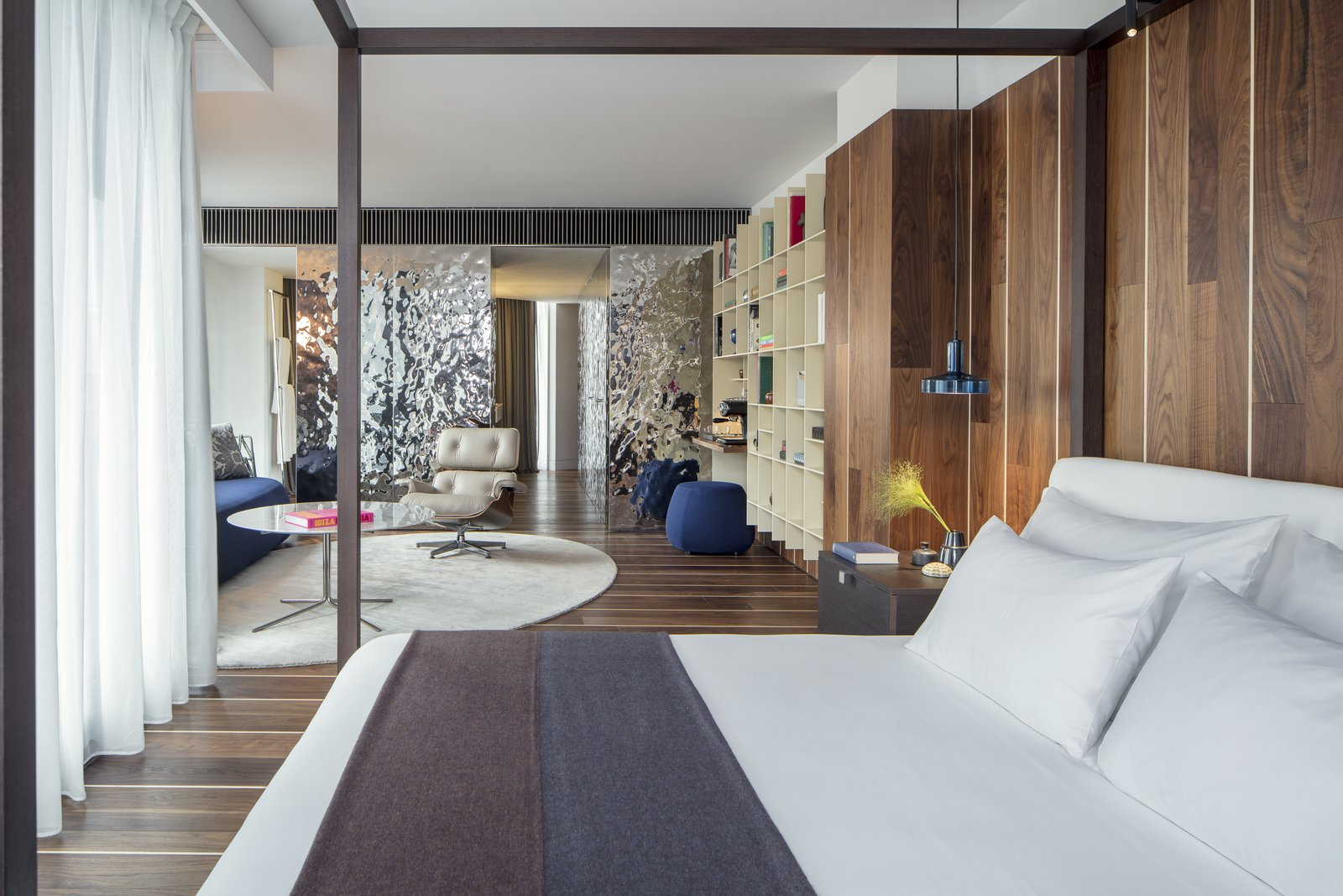 Bedroom, Bed, Pendant Lighting, and Dark Hardwood Floor  Photo 7 of 11 in A New Hotel That Celebrates Ibiza's Maritime History and Love For Parties