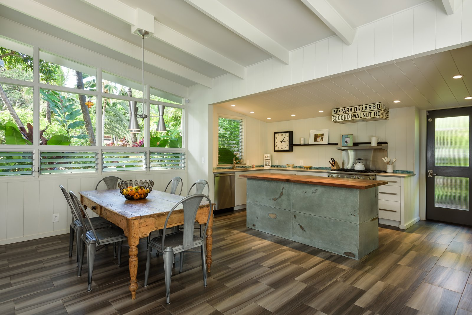 Dining, Table, Chair, Pendant, Ceramic Tile, and Recessed  Best Dining Ceramic Tile Recessed Photos from A Renovated Hawaiian Beach House From the 1950s Asks $1.79M