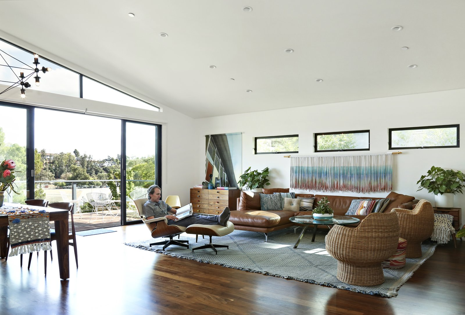 Living, Sectional, Coffee Tables, Pendant, Recessed, Dark Hardwood, Rug, Recliner, Ottomans, and Storage  Best Living Sectional Recliner Photos from A Silver Lake Home Built in 1939 Is Renovated From Top to Bottom