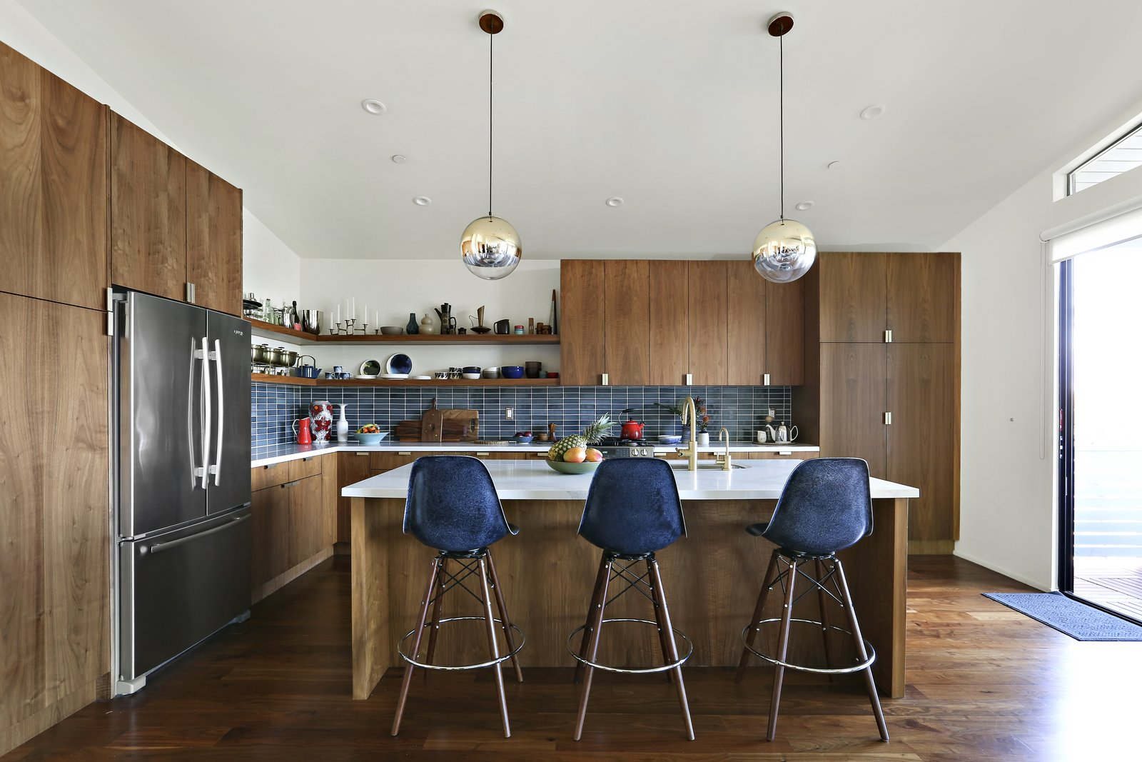 Kitchen, Refrigerator, Wood, Dark Hardwood, Pendant, Recessed, Range, Subway Tile, and Undermount  Best Kitchen Refrigerator Wood Dark Hardwood Range Photos from A Silver Lake Home Built in 1939 Is Renovated From Top to Bottom