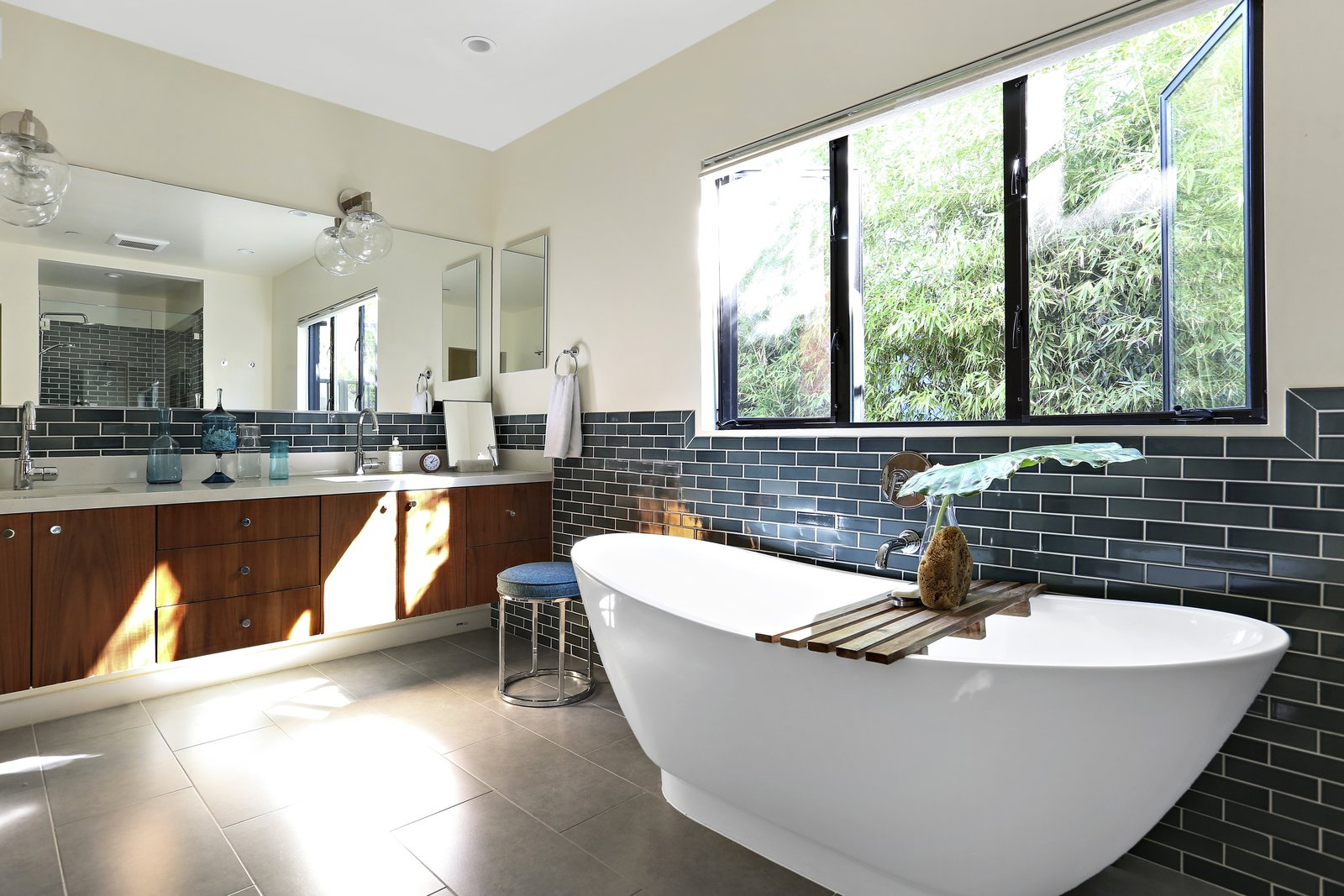 Bath Room, Freestanding Tub, Soaking Tub, Recessed Lighting, Drop In Sink, Wall Lighting, and Ceramic Tile Wall  Photos from A Silver Lake Home Built in 1939 Is Renovated From Top to Bottom
