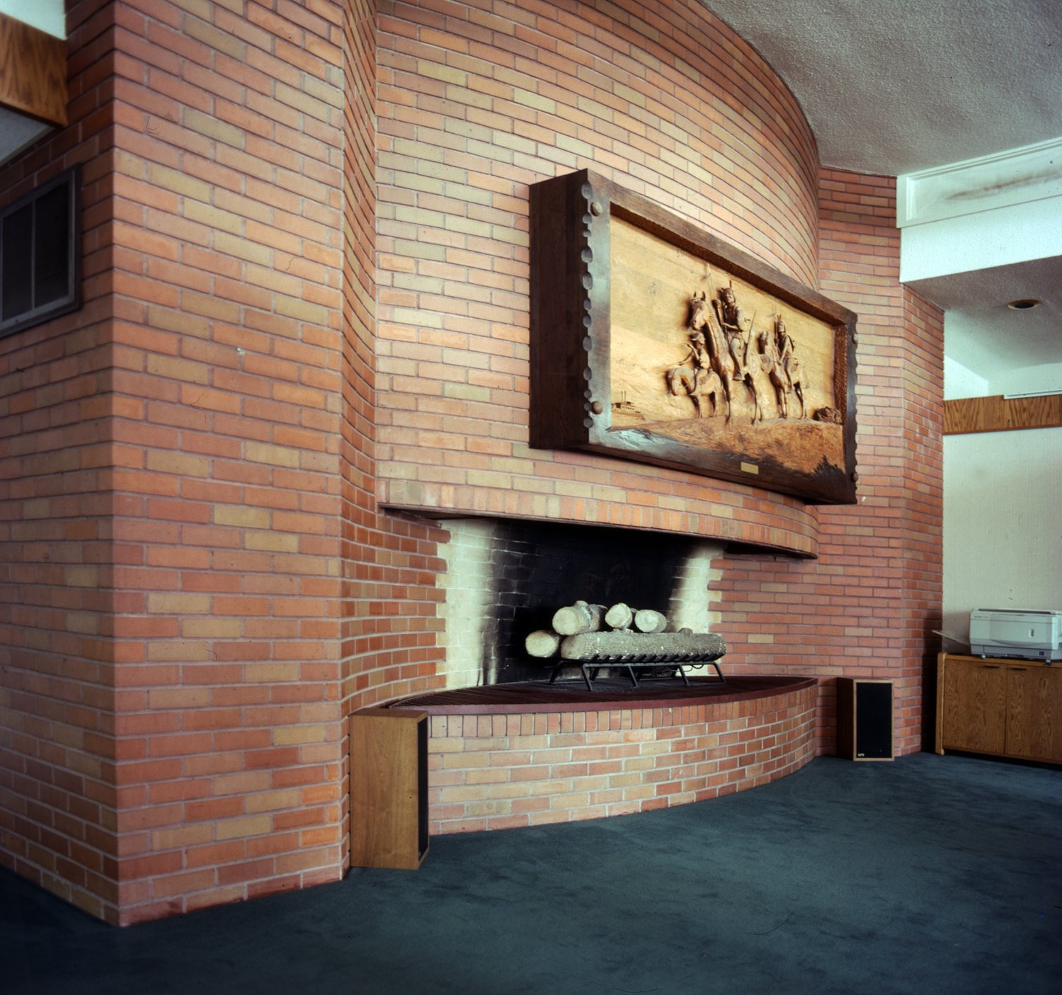 Living Room, Carpet Floor, Standard Layout Fireplace, and Wood Burning Fireplace  Photo 2 of 7 in Without a Buyer, This Frank Lloyd Wright Building Will Be Destroyed in 3 Days