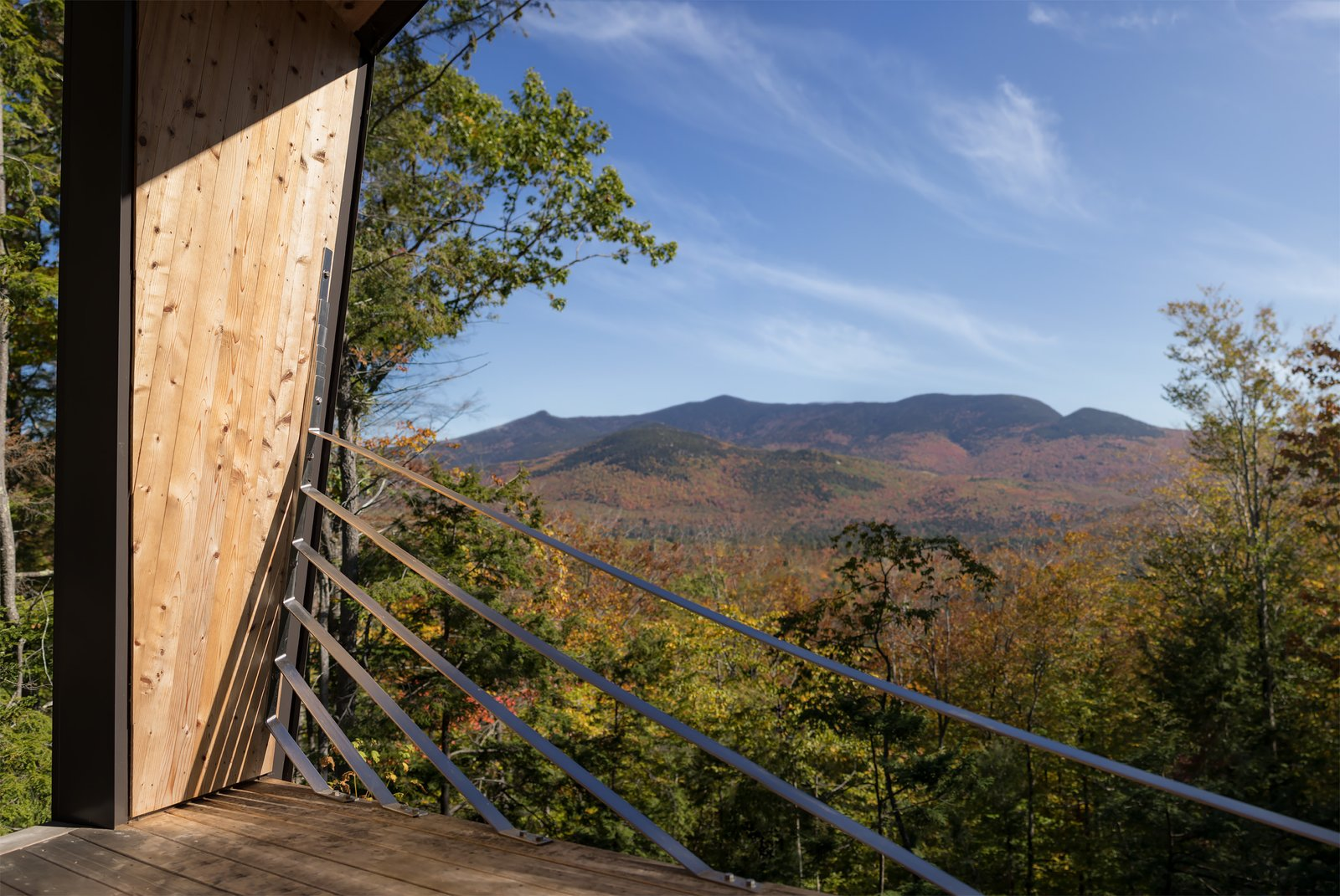 Outdoor, Metal, Slope, Wood, Trees, and Woodland  Best Outdoor Metal Slope Photos from A Prefab Cabin in New Hampshire Is a Magnificent Mountain Retreat