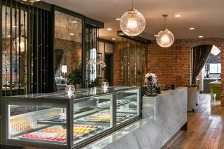 A candy counter greets hotel guests as a subtly elegant nod to the building's history.