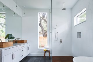 Davey McEathron Architecture installed slim windows to provide a light-filled, yet private, master bathroom in Chelsea House.