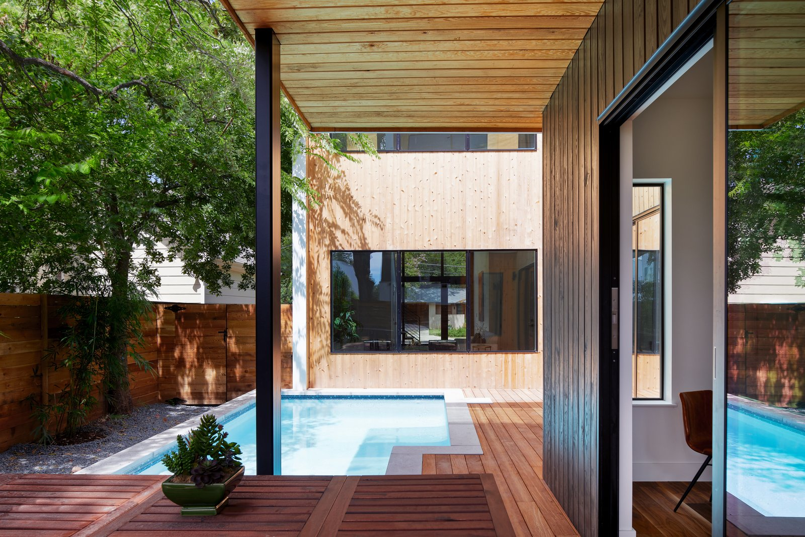 Outdoor, Standard Construction Pools, Tubs, Shower, Concrete Pools, Tubs, Shower, Shrubs, Swimming Pools, Tubs, Shower, Back Yard, Wood Patio, Porch, Deck, Small Pools, Tubs, Shower, Small Patio, Porch, Deck, Trees, Wood Fences, Wall, and Horizontal Fences, Wall Pool   Chelsea House by Davey McEathron Architecture