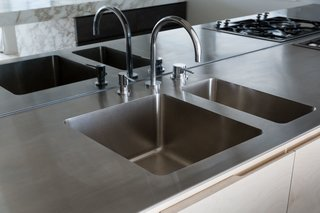 Custom-made stainless steel benchtop and integrated sink.