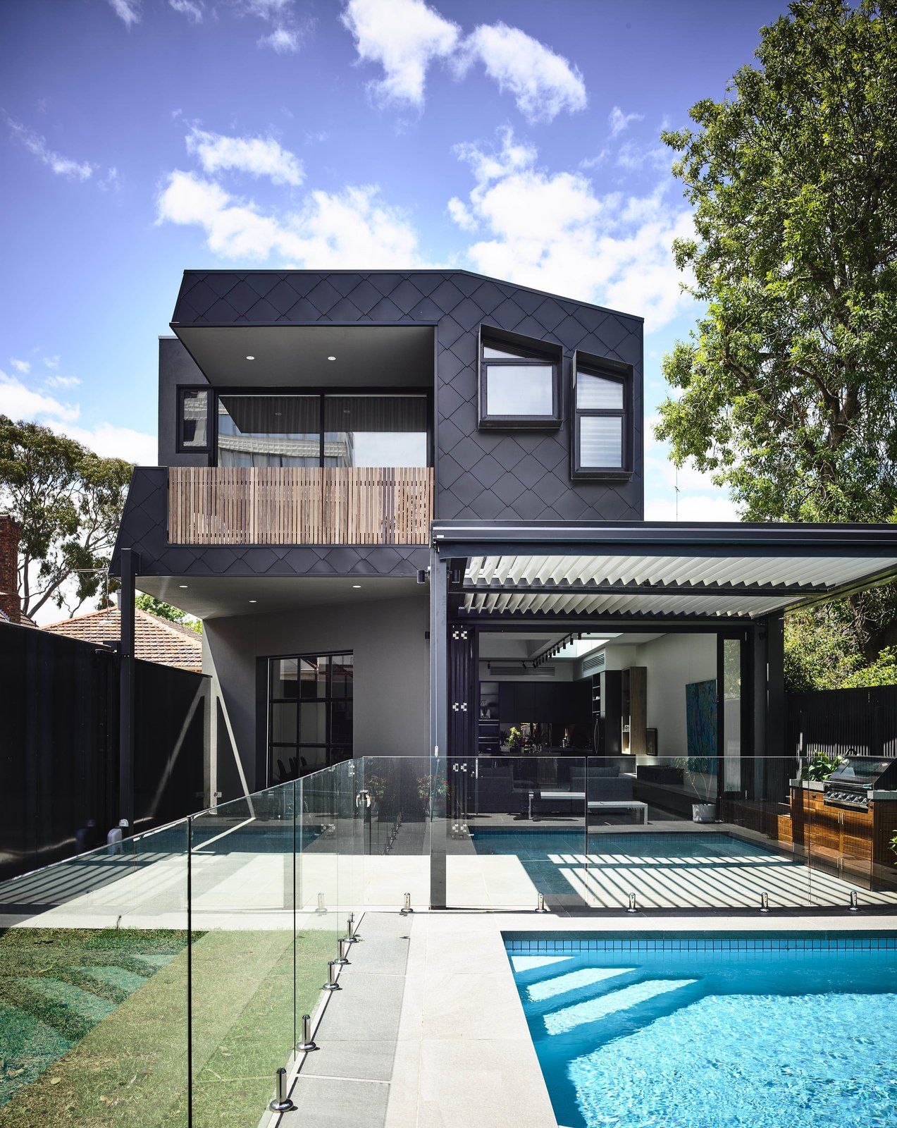 Swimming Pools, Tubs, Shower, Grass, Large Pools, Tubs, Shower, Back Yard, Exterior, House Building Type, and Metal Siding Material  Photo 3 of 4 in Top 4 Homes of the Week With Impressive Backyards from Saint Kilda West
