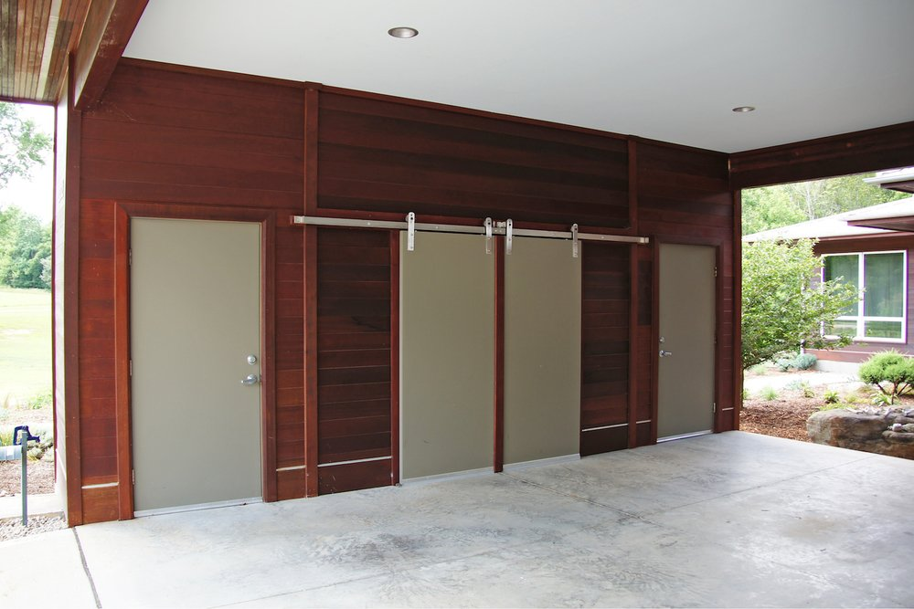 Closet, Storage Space, Doors, Wood, Exterior, Metal, and Sliding  Doors Wood Sliding Metal Photos from The Holt-Bottomly Project