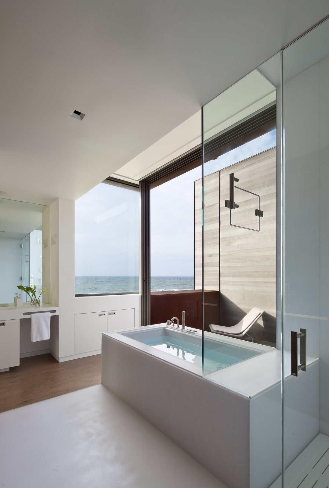 Bath Room, Engineered Quartz Counter, Enclosed Shower, Medium Hardwood Floor, Soaking Tub, and Recessed Lighting  Sagaponack, NY