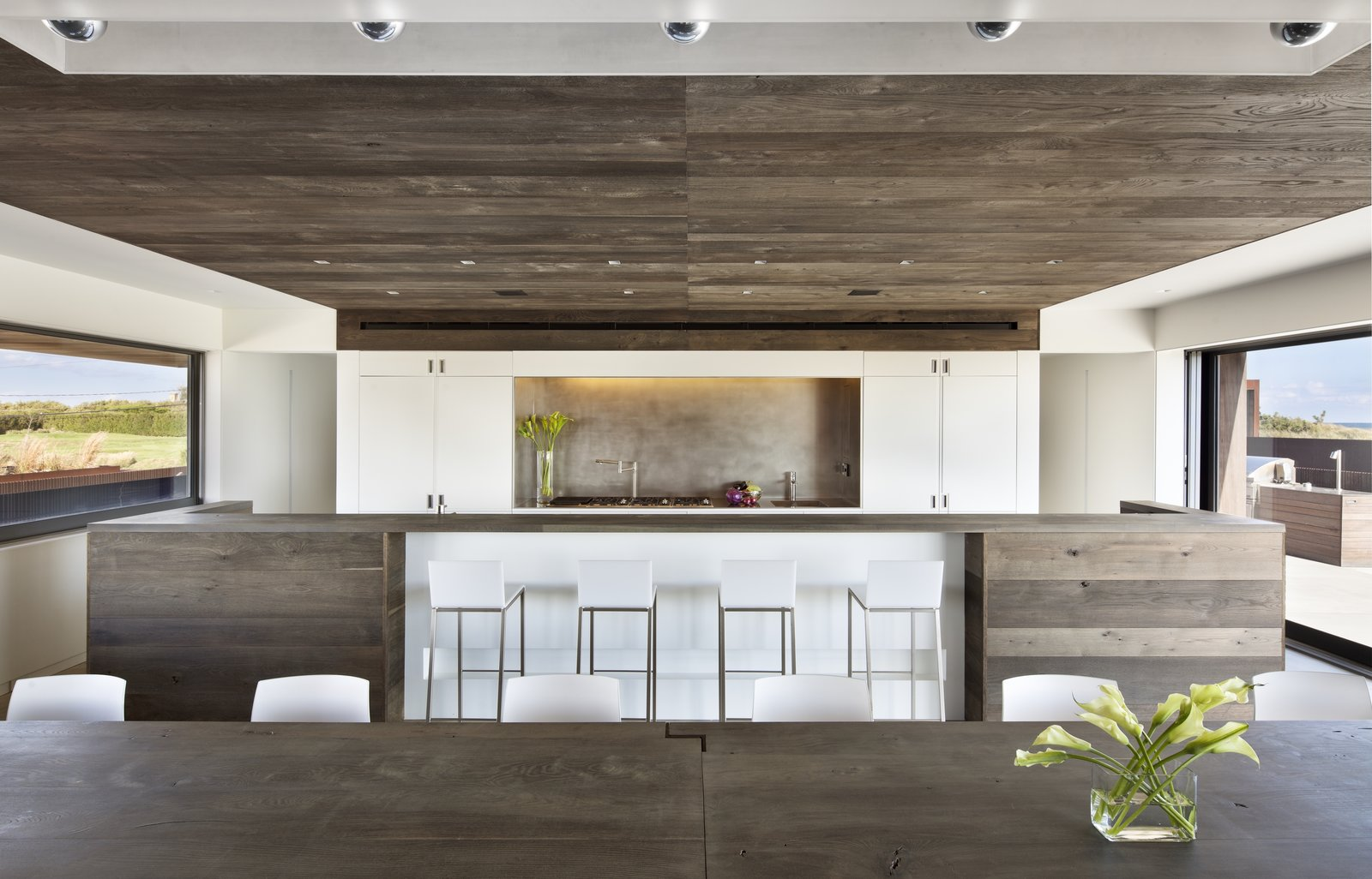 Dining Room, Bar, Table, Chair, Stools, Ceiling Lighting, and Ceramic Tile Floor  Sagaponack, NY