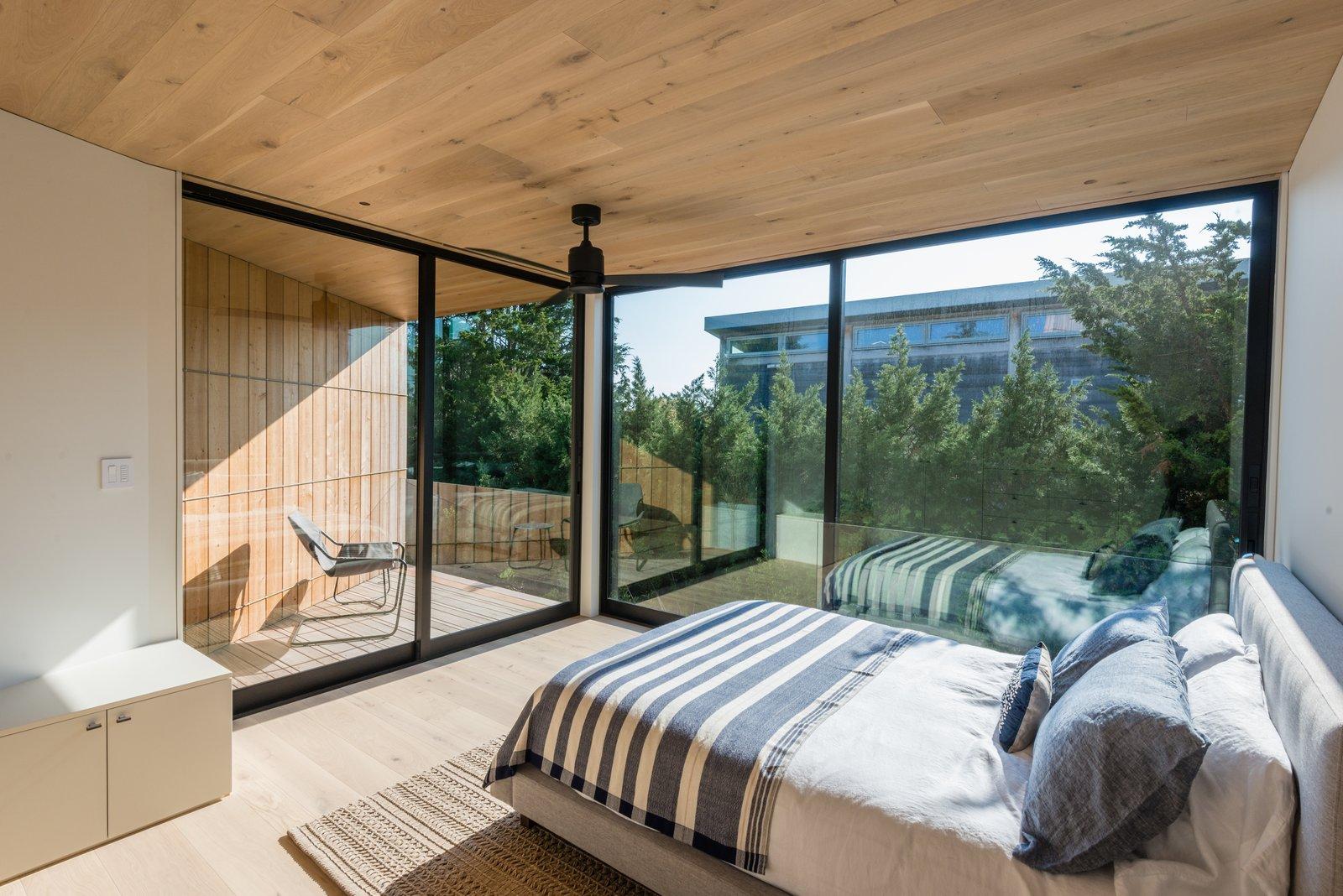 Bedroom, Bed, Dresser, Ceiling Lighting, Chair, Light Hardwood Floor, and Recessed Lighting  Amagansett Landmark