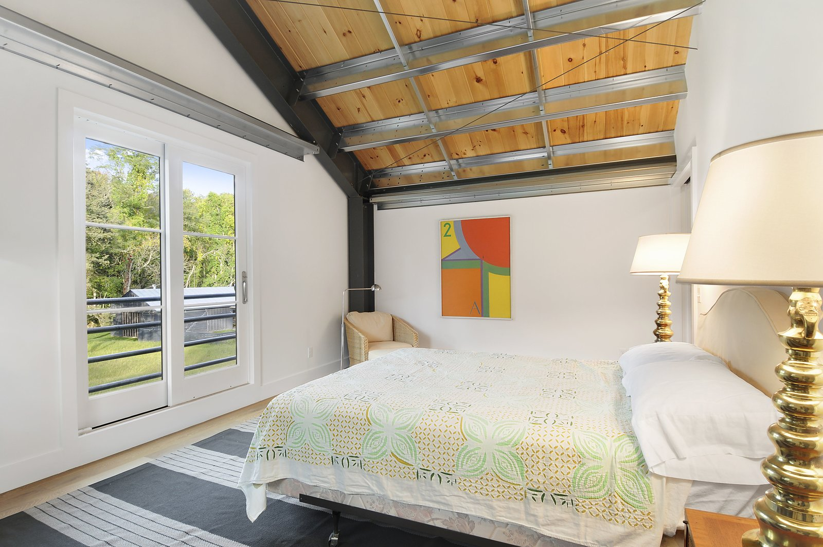 Bedroom, Bed, Chair, Night Stands, Table Lighting, Light Hardwood Floor, and Rug Floor  North Haven Compound