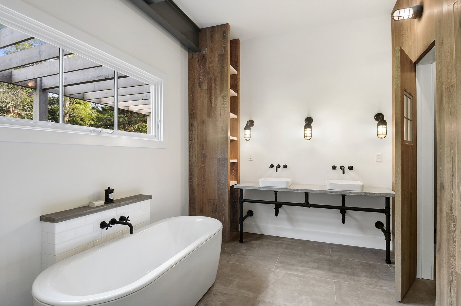 Bath Room, Concrete Counter, Porcelain Tile Floor, Vessel Sink, Freestanding Tub, Enclosed Shower, Accent Lighting, Wall Lighting, and Ceiling Lighting  North Haven Compound