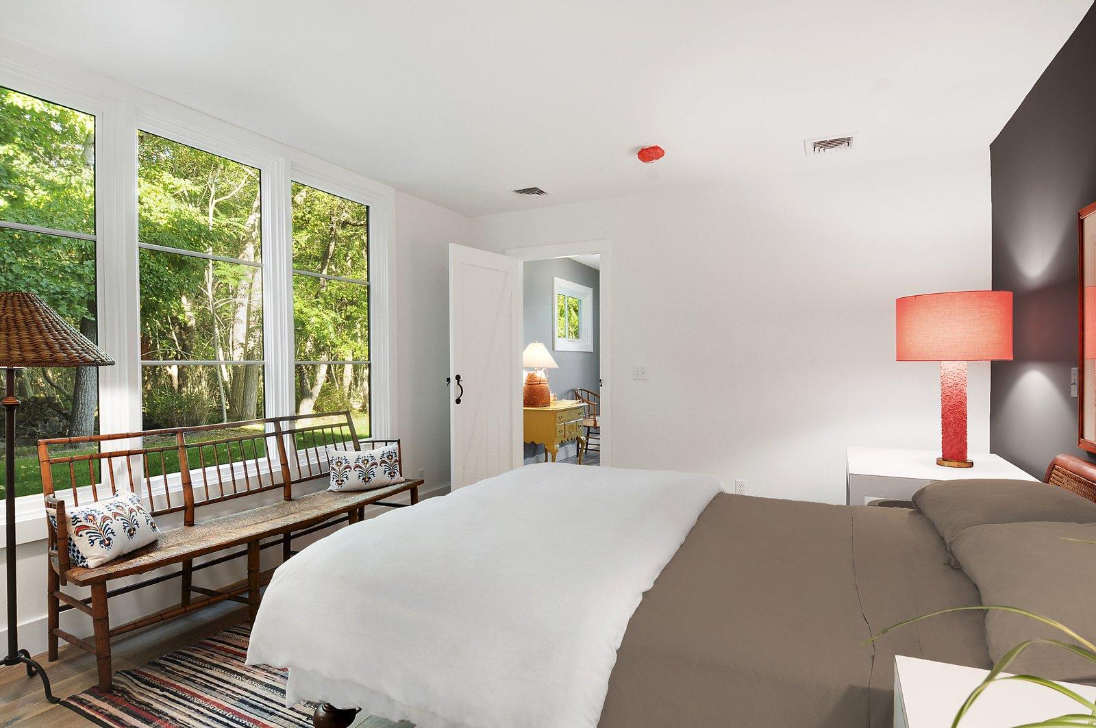 Bedroom, Bed, Night Stands, Chair, Bench, Lamps, Ceiling Lighting, Recessed Lighting, Light Hardwood Floor, and Rug Floor  North Haven Compound