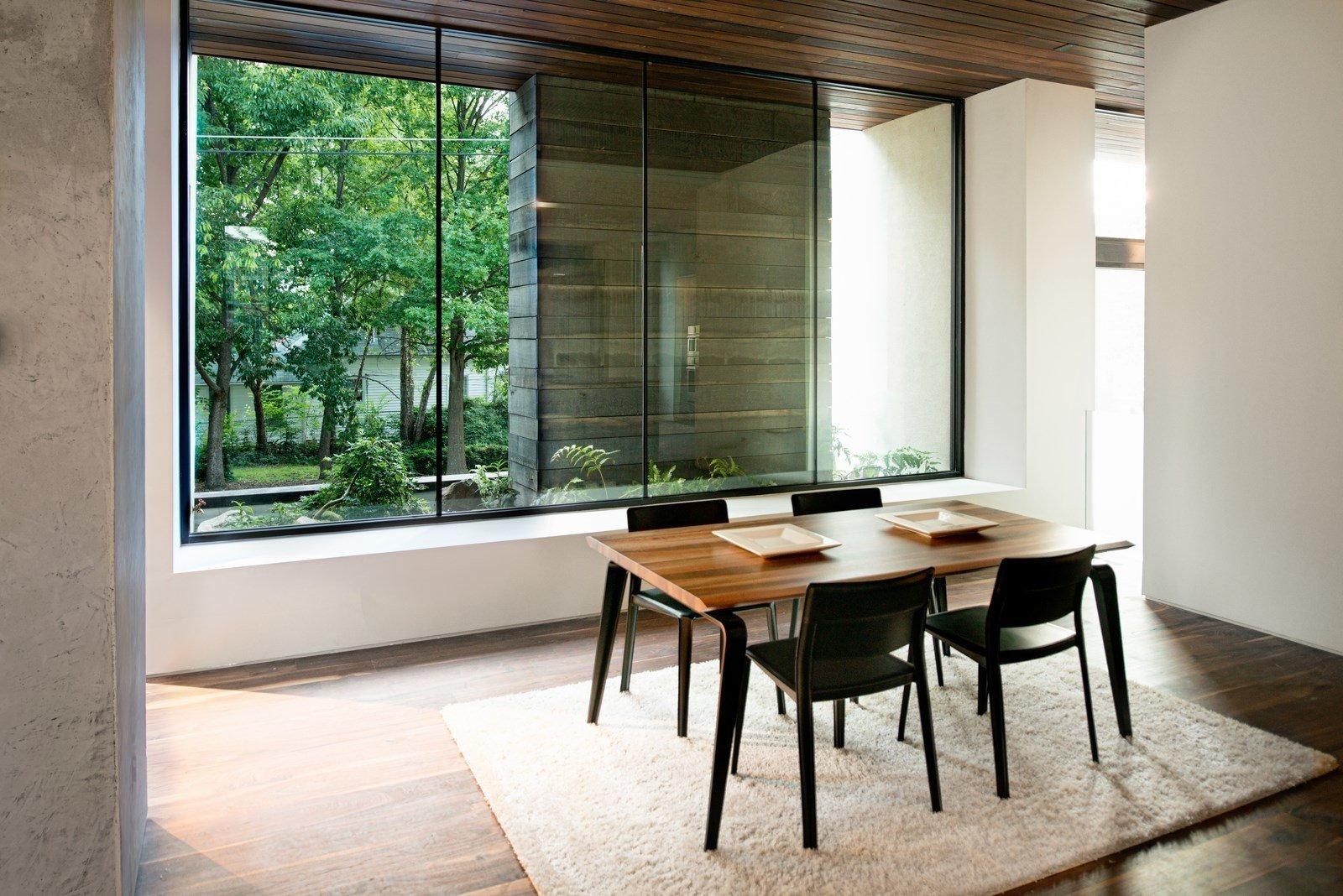 Dining Room, Medium Hardwood Floor, Table, and Chair  Alaska House