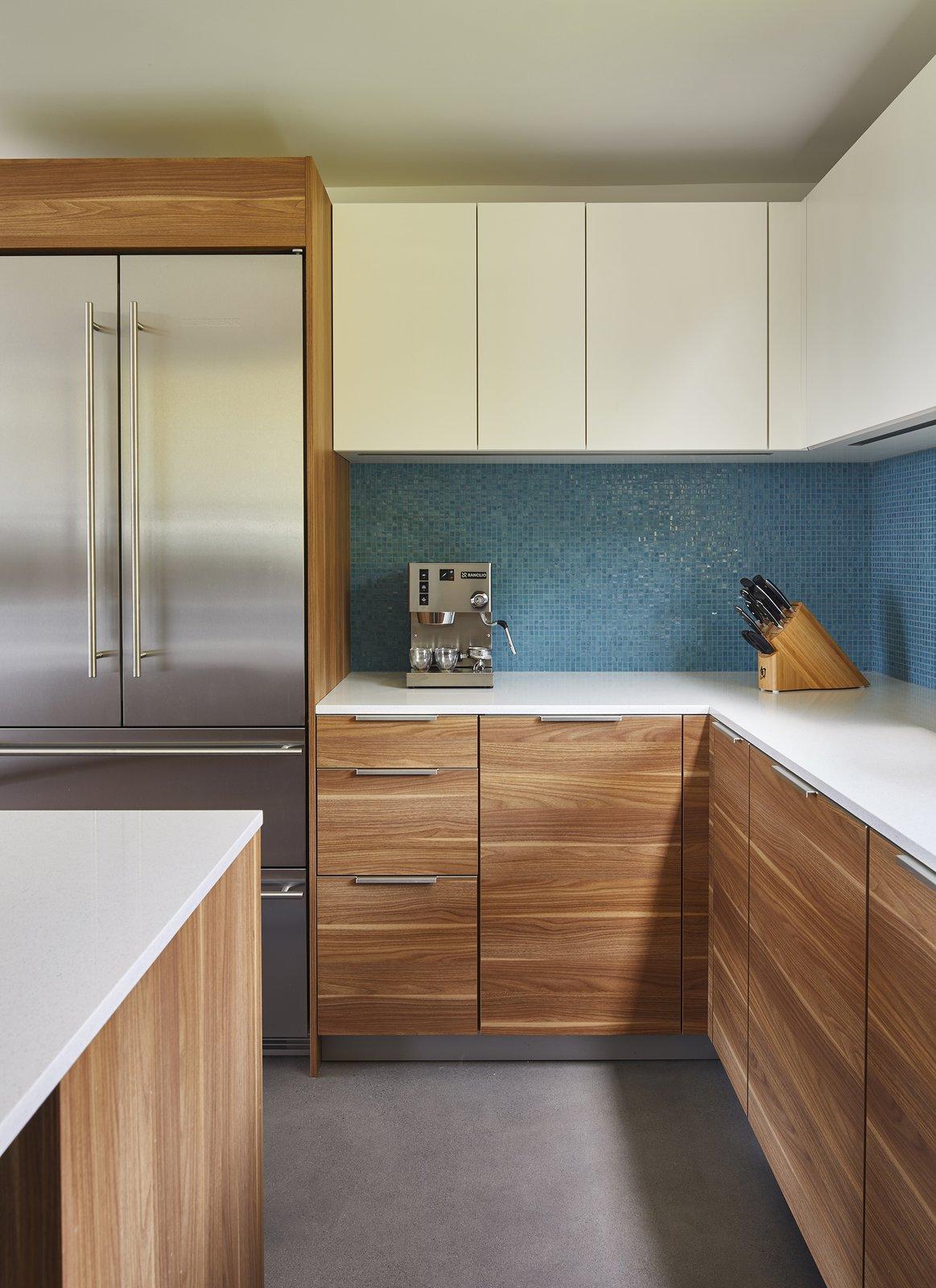 Kitchen, Engineered Quartz Counter, Refrigerator, Mosaic Tile Backsplashe, and Wood Cabinet  Issaquah Highlands Residence by Studio Zerbey Architecture & Design