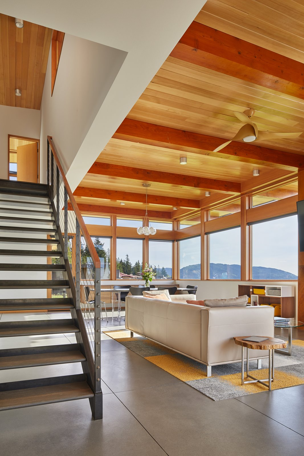 Living Room, Concrete Floor, Sofa, and Ceiling Lighting  Issaquah Highlands Residence by Studio Zerbey Architecture