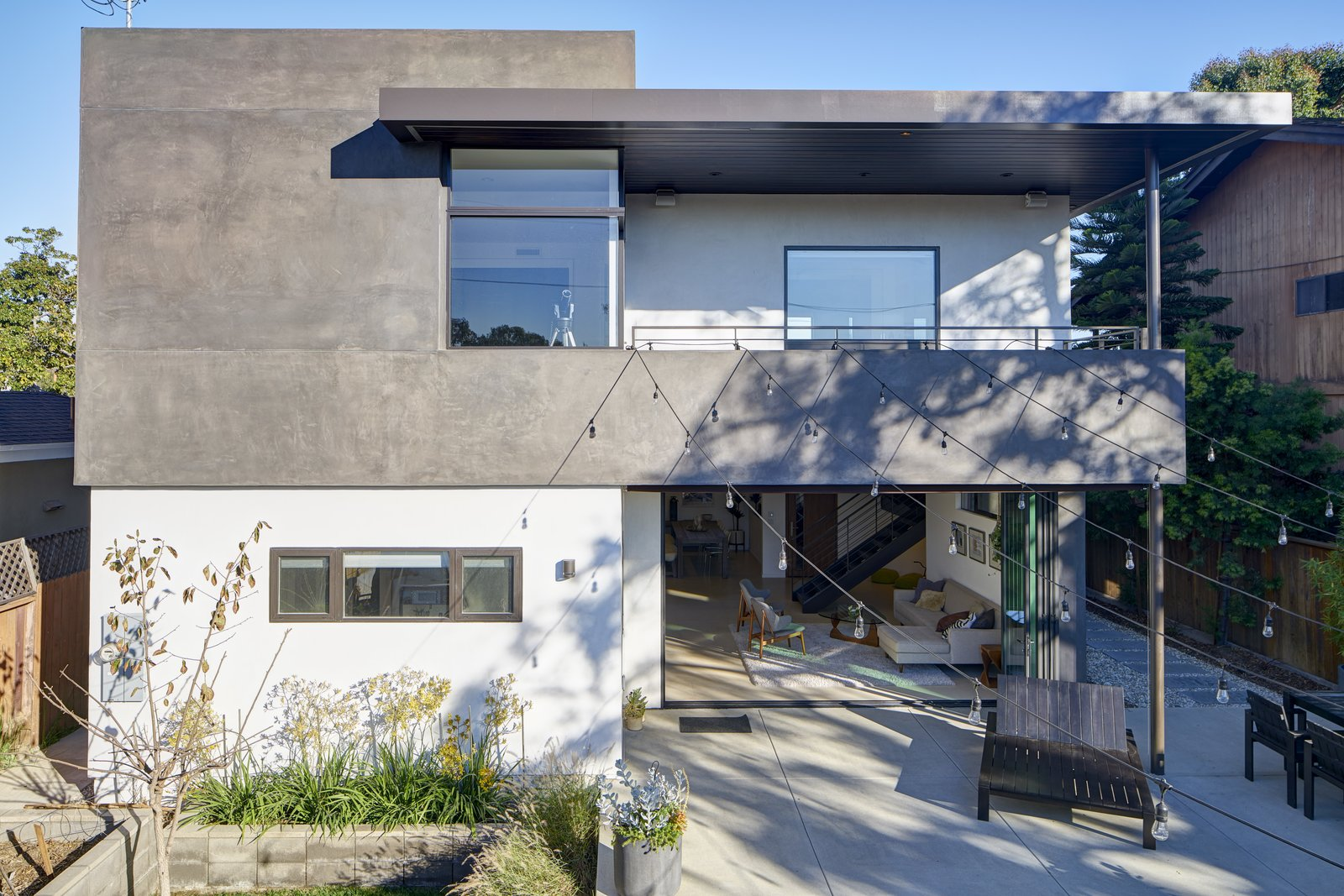 Wood Tread, Metal Railing, Back Yard, Outdoor, and Concrete Patio, Porch, Deck  Project Coalesce by Colega Architects