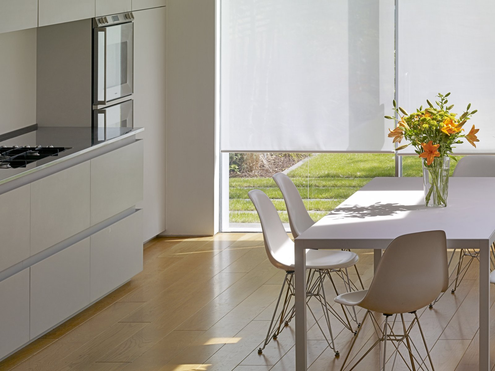 Light Hardwood Floor, White Cabinet, Dining Room, Table, and Chair  Elm Grove by Thompson + Baroni