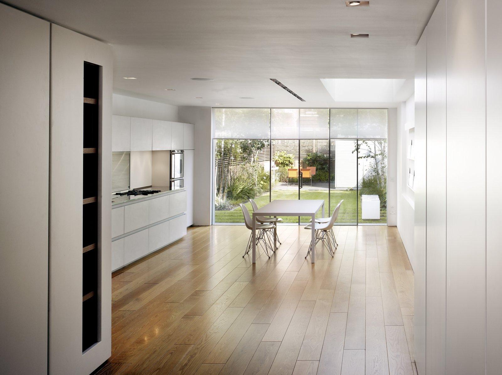 Dining Room, Chair, Table, Medium Hardwood Floor, and Recessed Lighting  Elm Grove by Thompson + Baroni