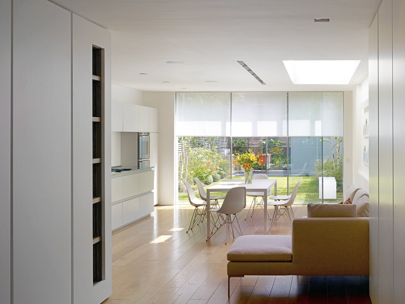 Chair, Kitchen, Table, White Cabinet, and Light Hardwood Floor  Elm Grove by Thompson + Baroni