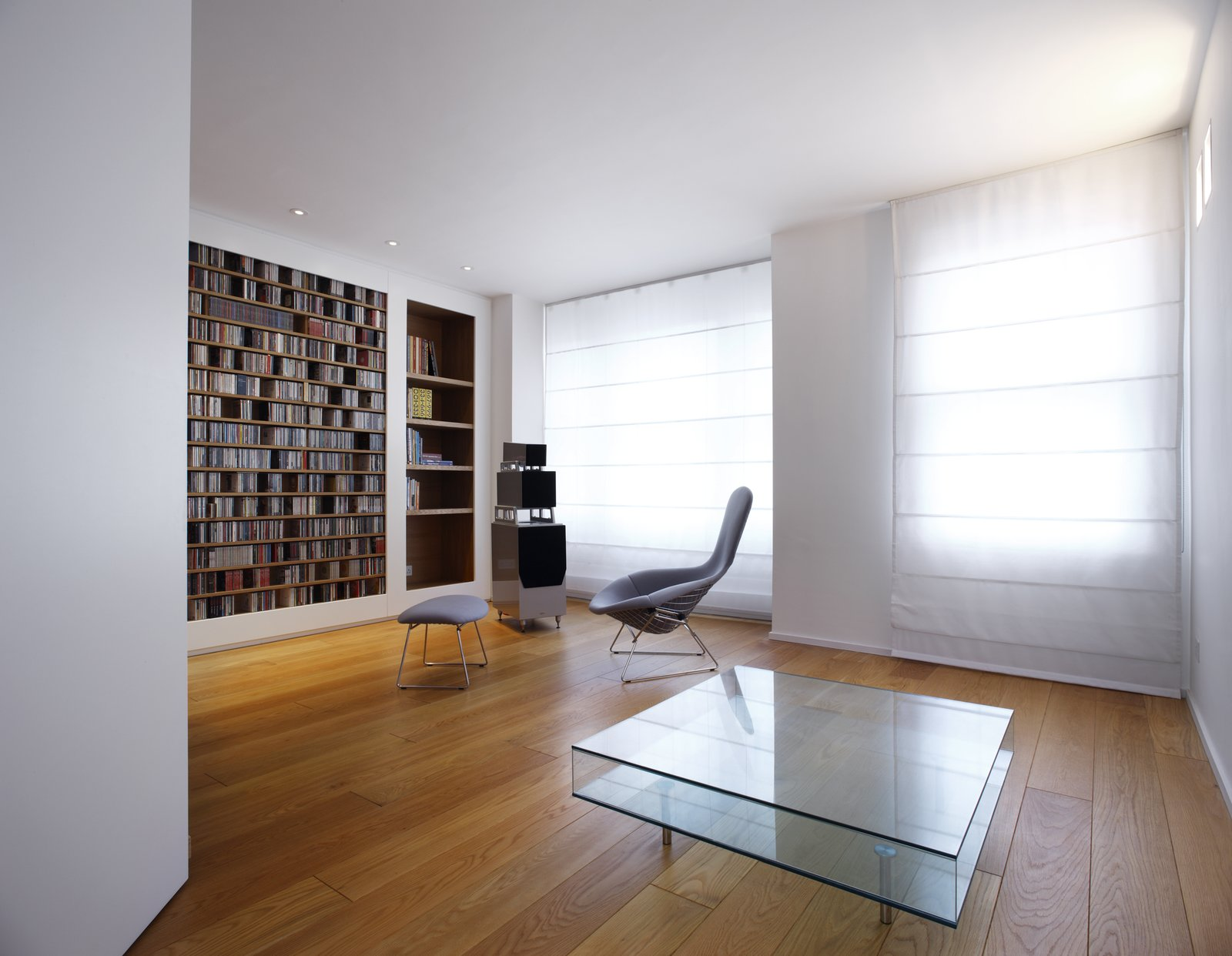 Living Room, Coffee Tables, Chair, and Bookcase  Elm Grove by Thompson + Baroni