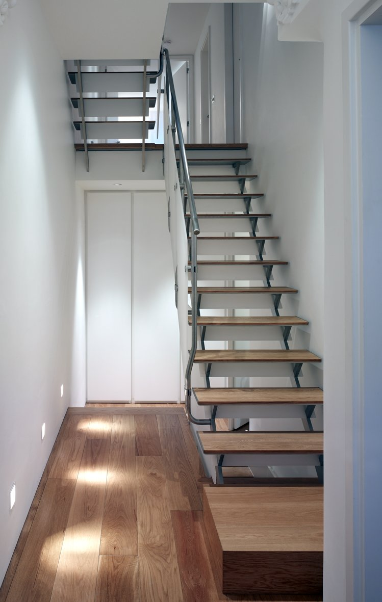 Staircase, Metal Tread, Wood Tread, and Metal Railing  Elm Grove by Thompson + Baroni