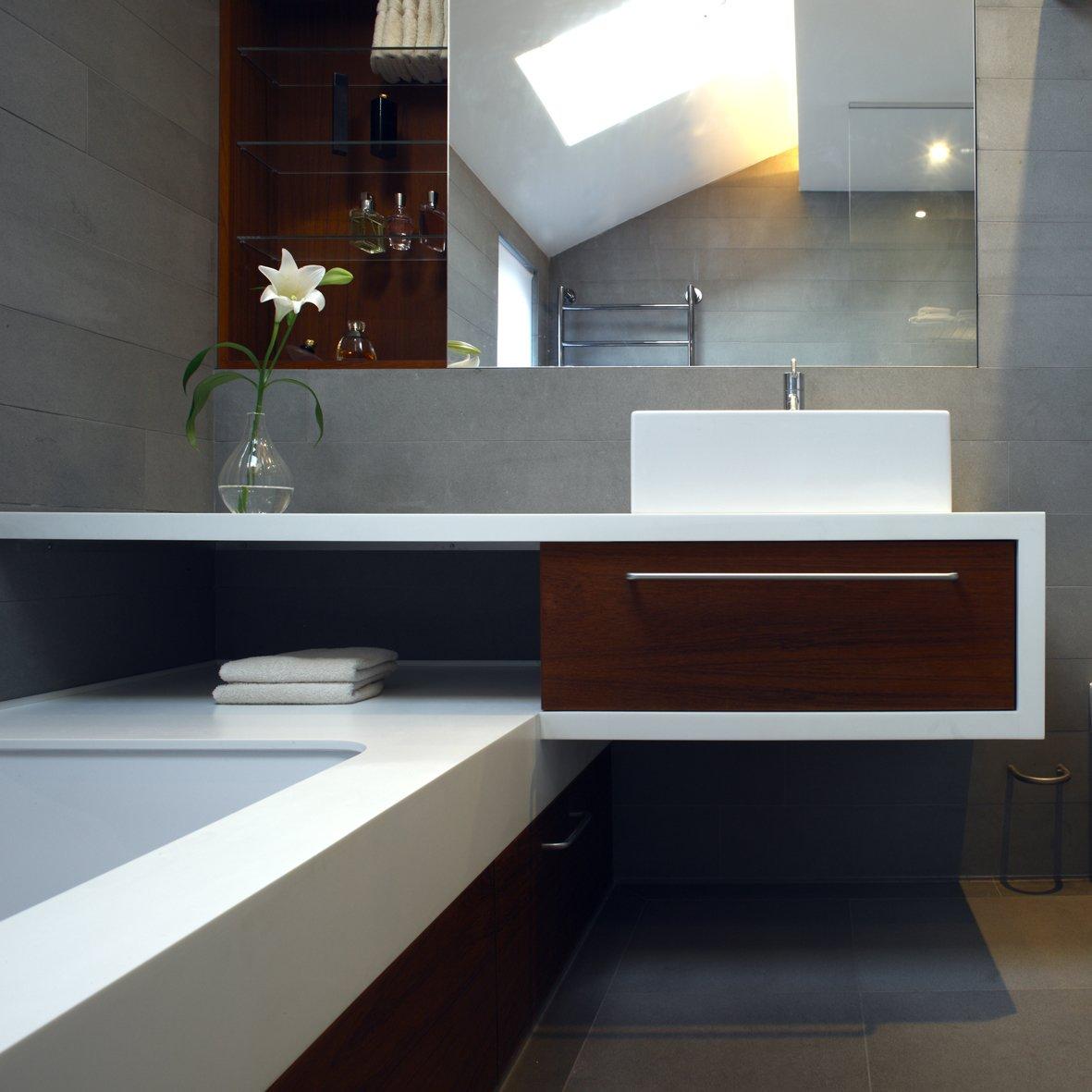 Bath Room, Vessel Sink, Quartzite Counter, Concrete Floor, and Undermount Tub  Elm Grove by Thompson + Baroni