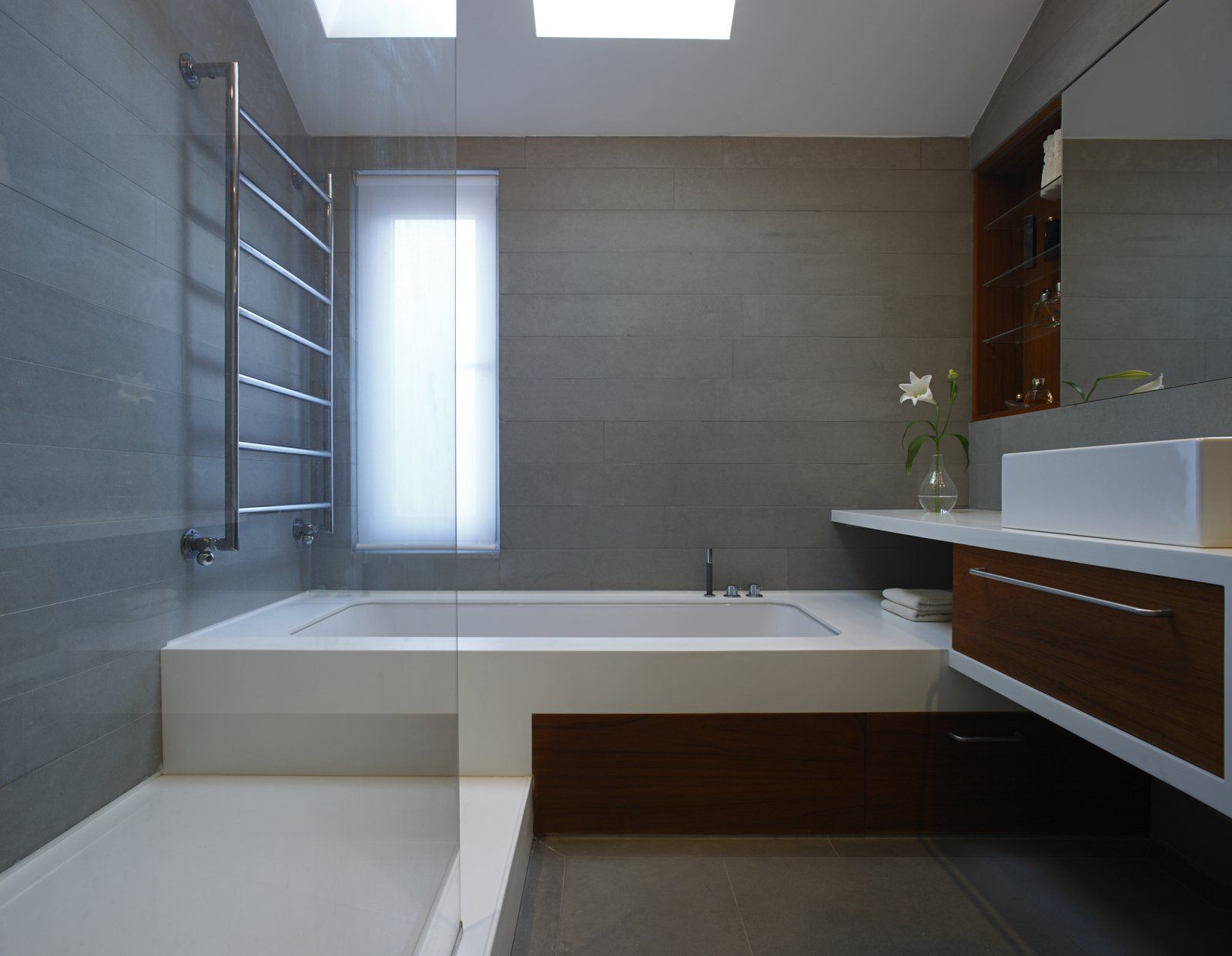 Bath Room, Quartzite Counter, Concrete Floor, Soaking Tub, Undermount Tub, and Enclosed Shower  Elm Grove by Thompson + Baroni