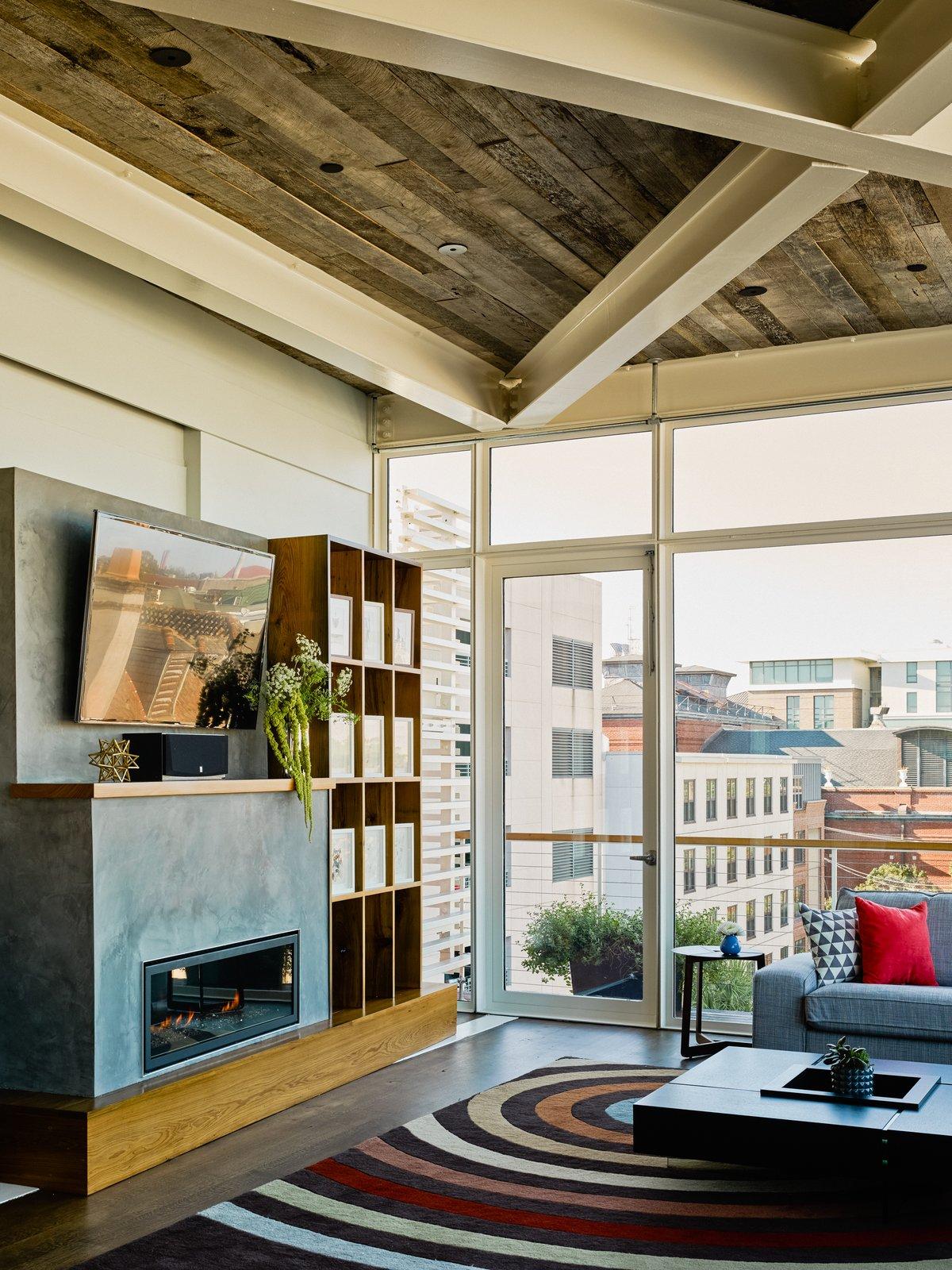 Living Room, Coffee Tables, Sofa, Dark Hardwood Floor, and Gas Burning Fireplace  SKY residence