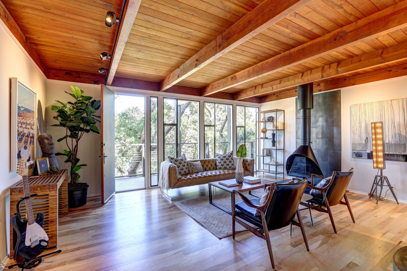 Living, Sofa, Floor, Light Hardwood, Hanging, Wood Burning, Track, Coffee Tables, Console Tables, and Bookcase  Best Living Track Floor Photos from Bathrooms