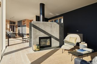 In the living room, the design team poured concrete in place using smooth board formwork to create the seamless fireplace.