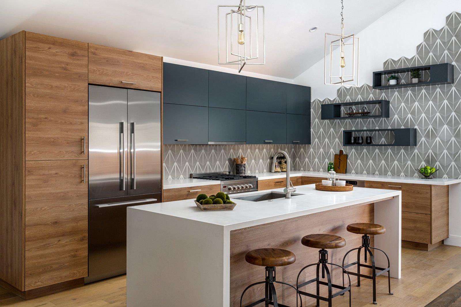 Kitchen, Refrigerator, Range, Range Hood, Wood, Laminate, Light Hardwood, Ceramic Tile, and Ceiling  Best Kitchen Laminate Ceiling Photos from A Dwell-Like Kitchen In Costa Mesa