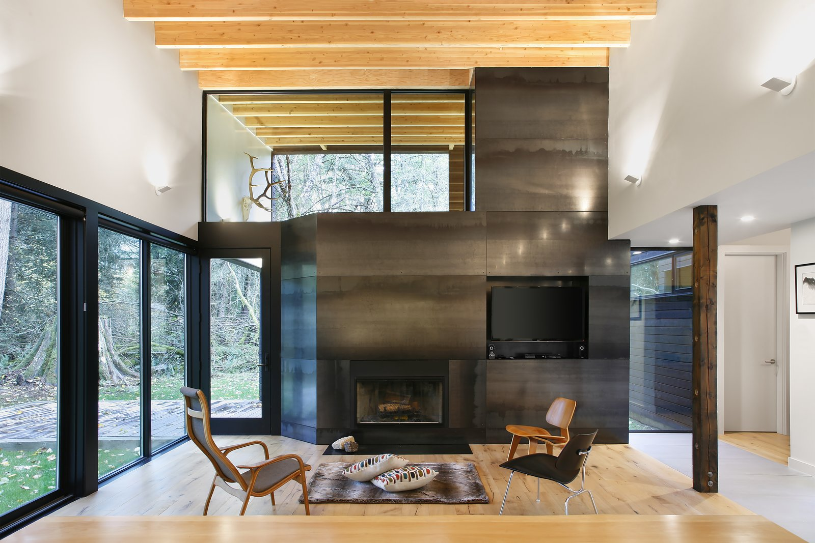 Living Room, Chair, Standard Layout Fireplace, and Light Hardwood Floor  Courtyard House on a River by Robert Hutchison Architecture