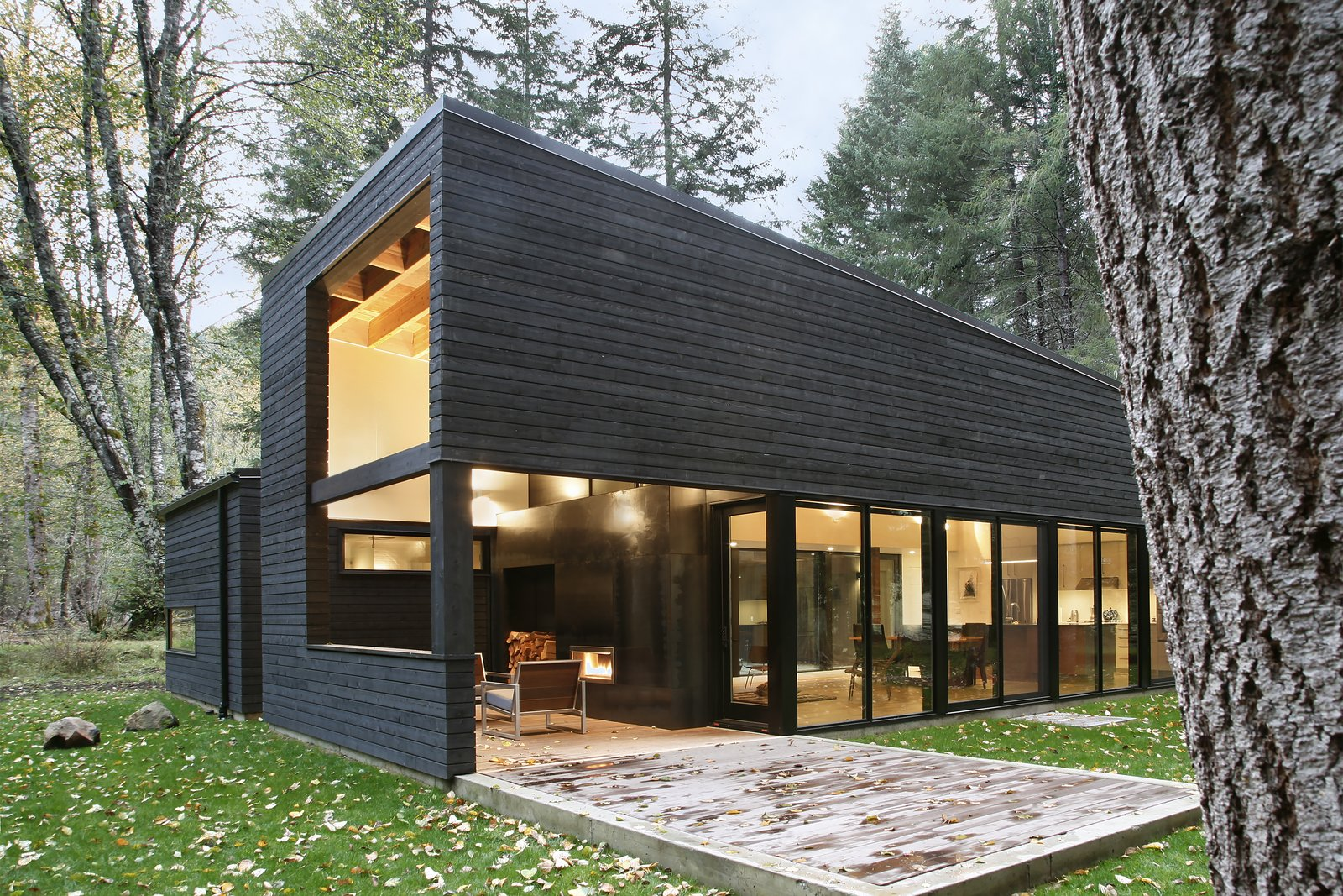 Exterior, Cabin Building Type, House Building Type, and Wood Siding Material  Photos from Courtyard House on a River