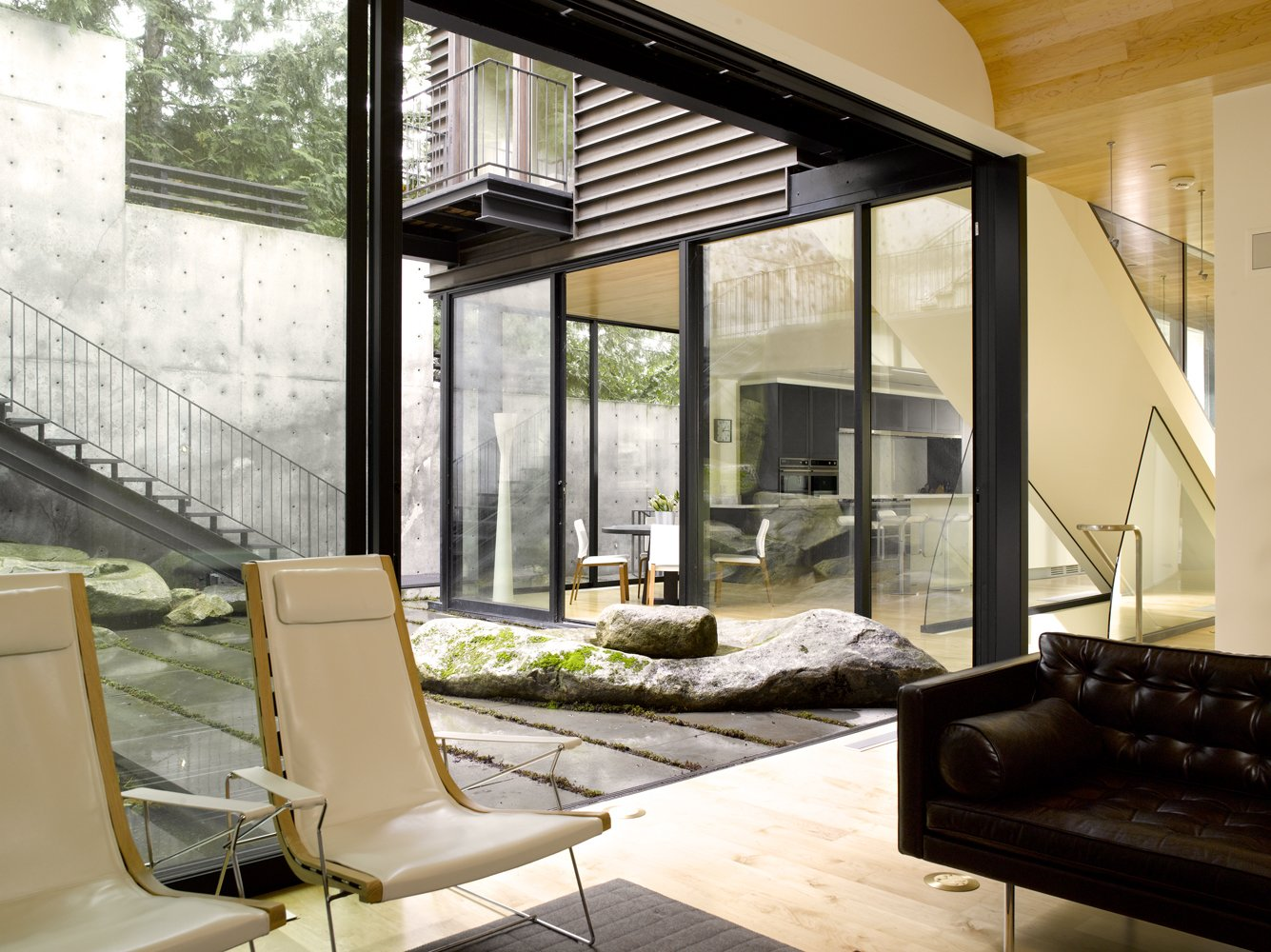 Living Room, Chair, Coffee Tables, Sofa, Light Hardwood Floor, and Ceiling Lighting  Courtyard House on a Steep Site by Robert Hutchison Architecture
