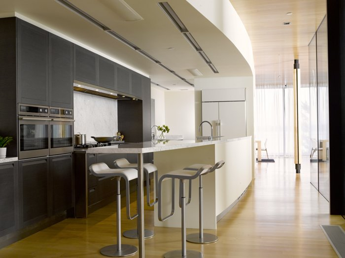 Kitchen, Refrigerator, Wall Oven, Ceiling Lighting, and Light Hardwood Floor  Courtyard House on a Steep Site by Robert Hutchison Architecture