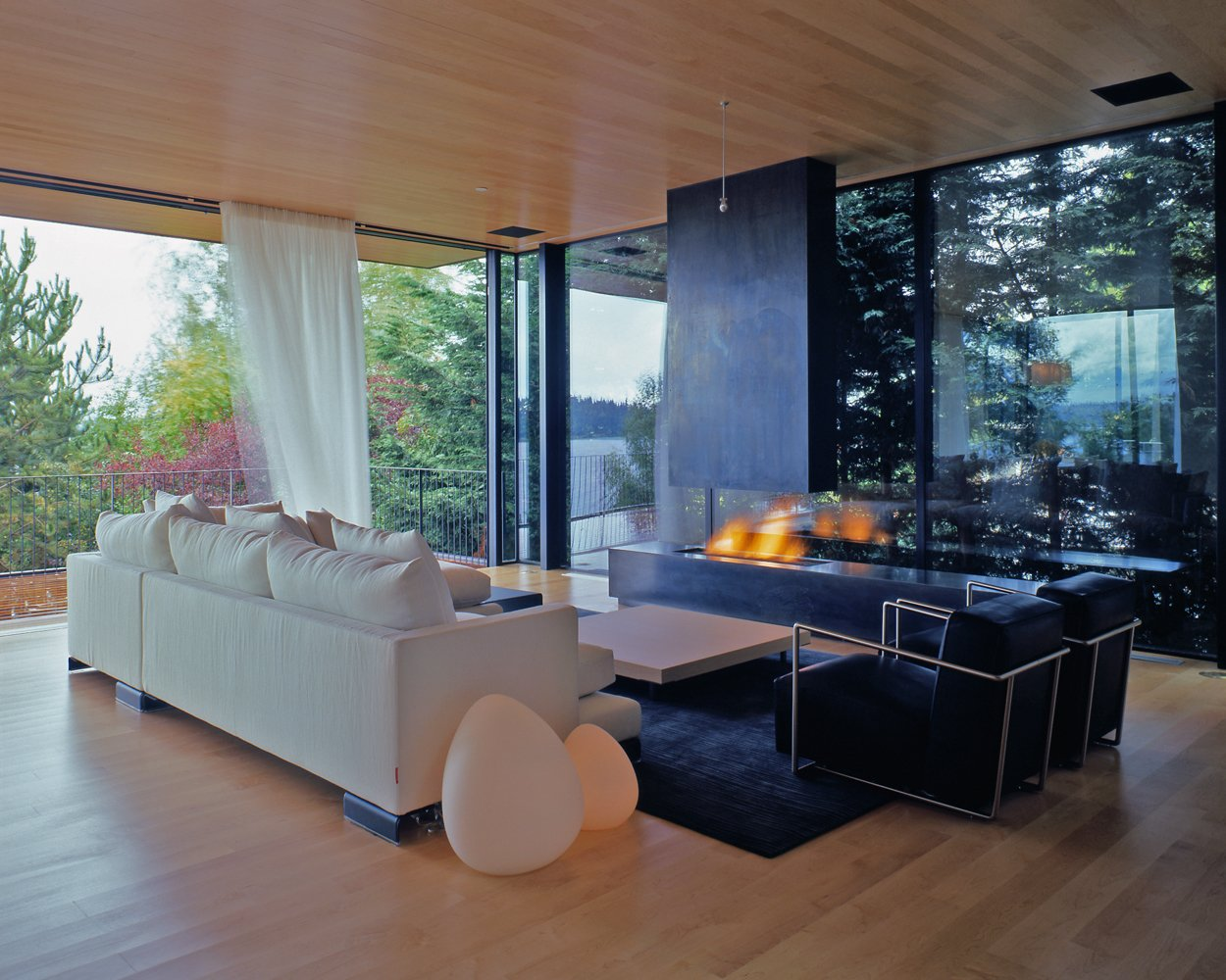 Tagged: Living Room, Chair, Sofa, and Light Hardwood Floor.  Courtyard House on a Steep Site by Robert Hutchison Architecture