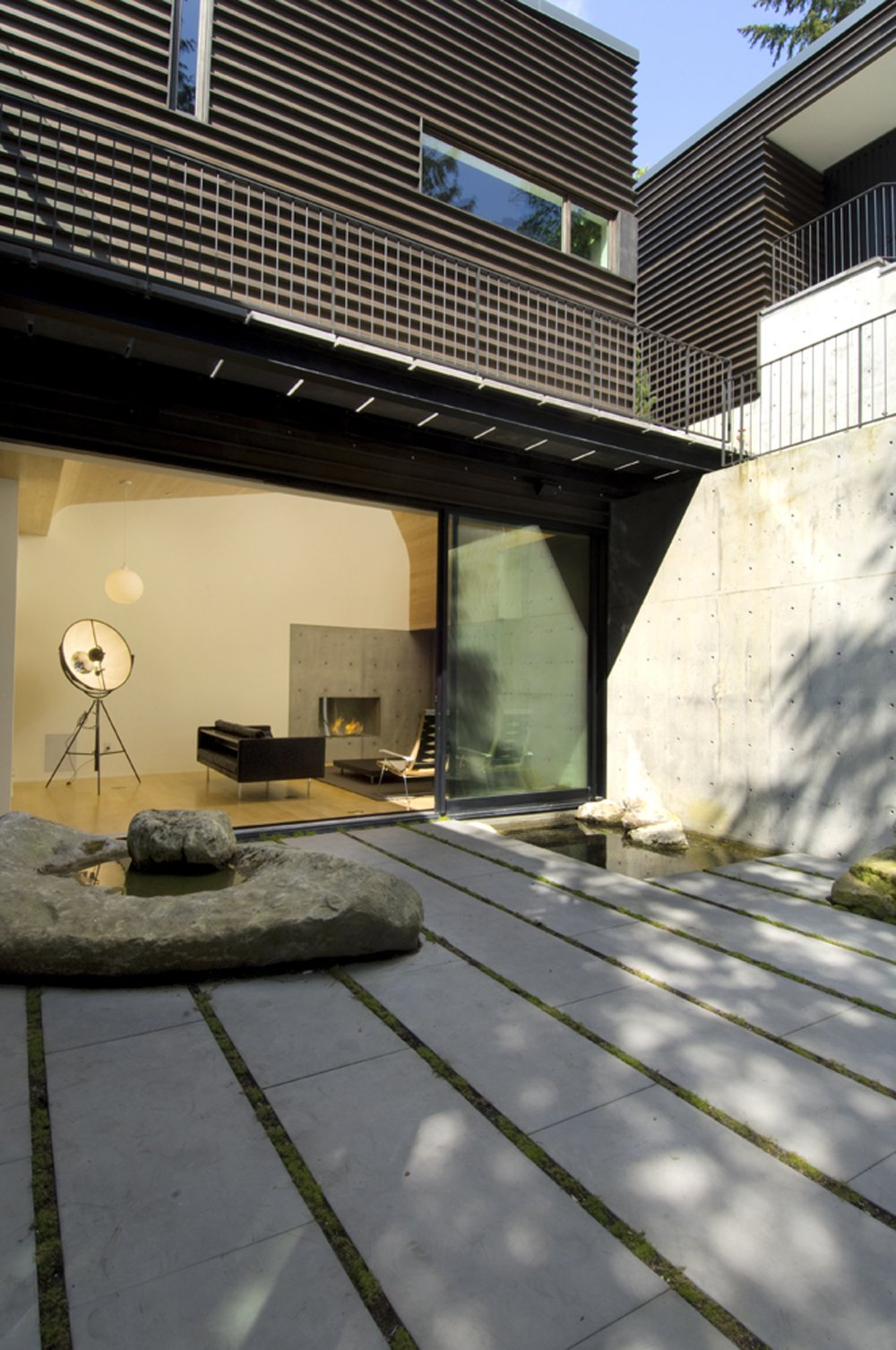 Outdoor and Boulders  Courtyard House on a Steep Site by Robert Hutchison Architecture