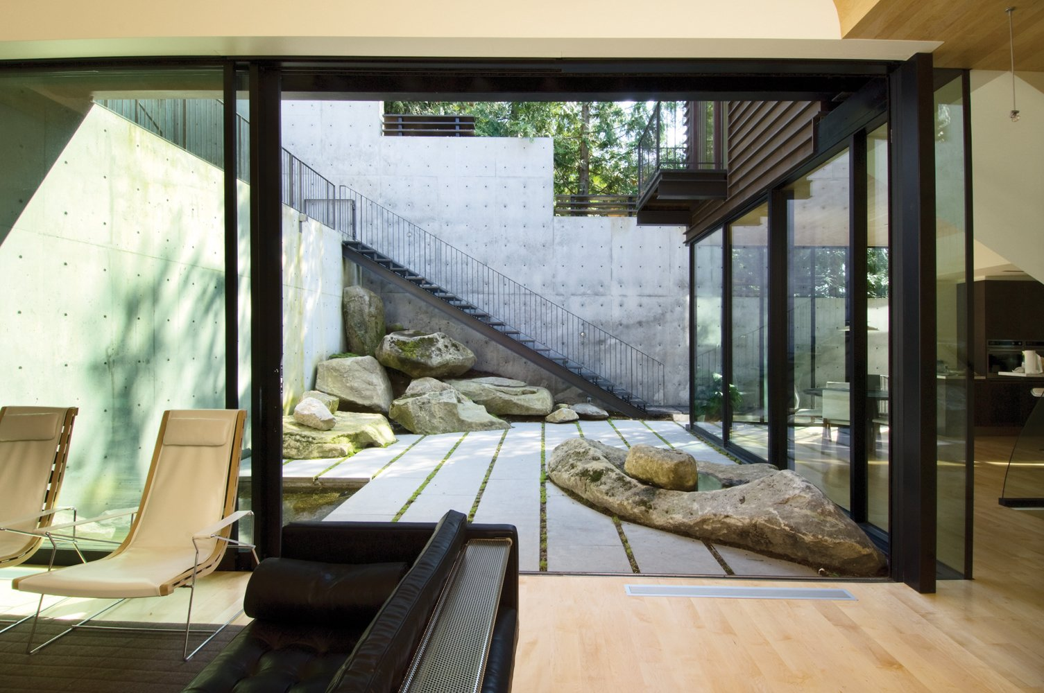 Outdoor, Small Pools, Tubs, Shower, and Boulders  Courtyard House on a Steep Site by Robert Hutchison Architecture