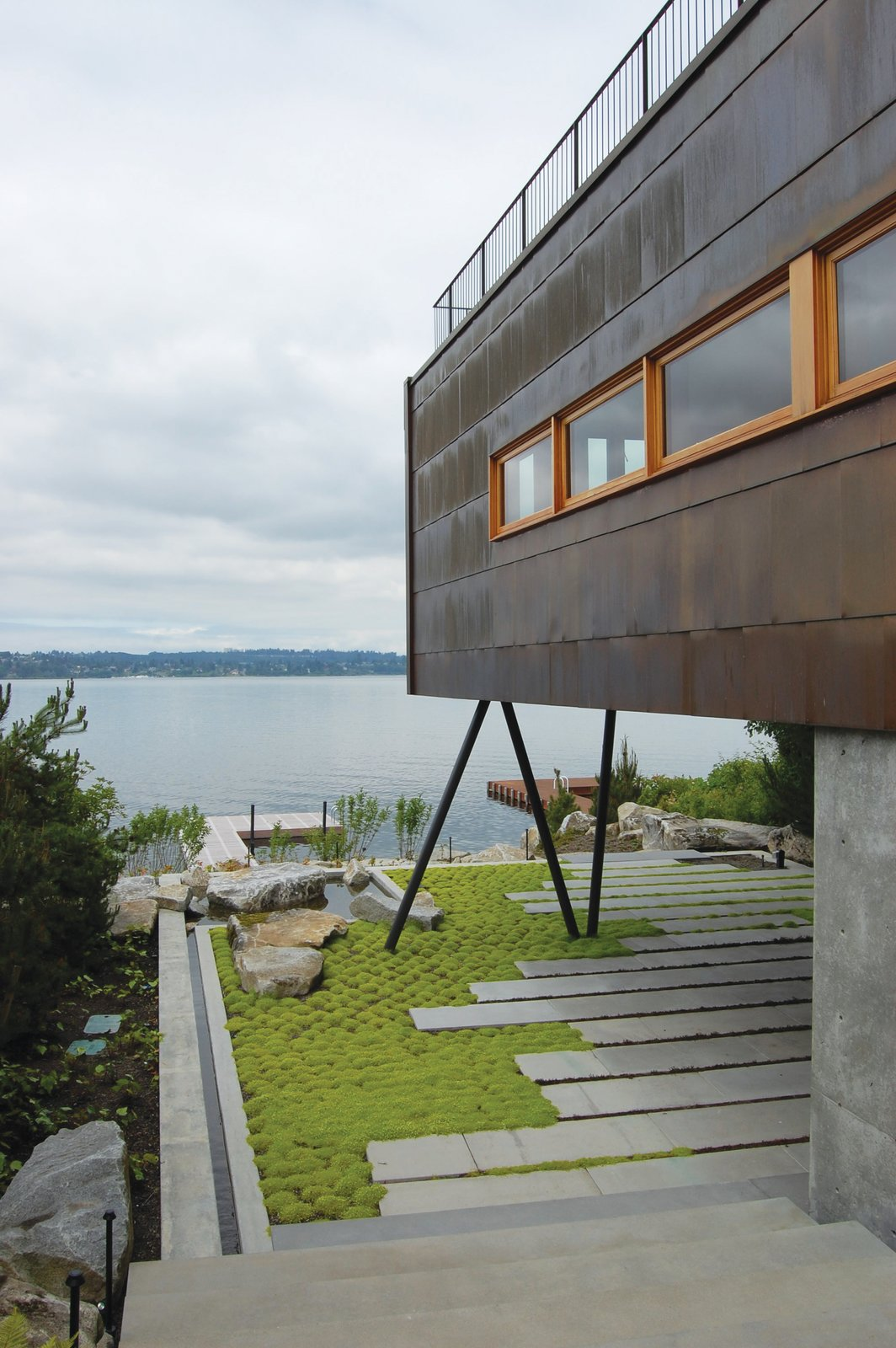 Outdoor  Guest House on a Lake by Robert Hutchison Architecture