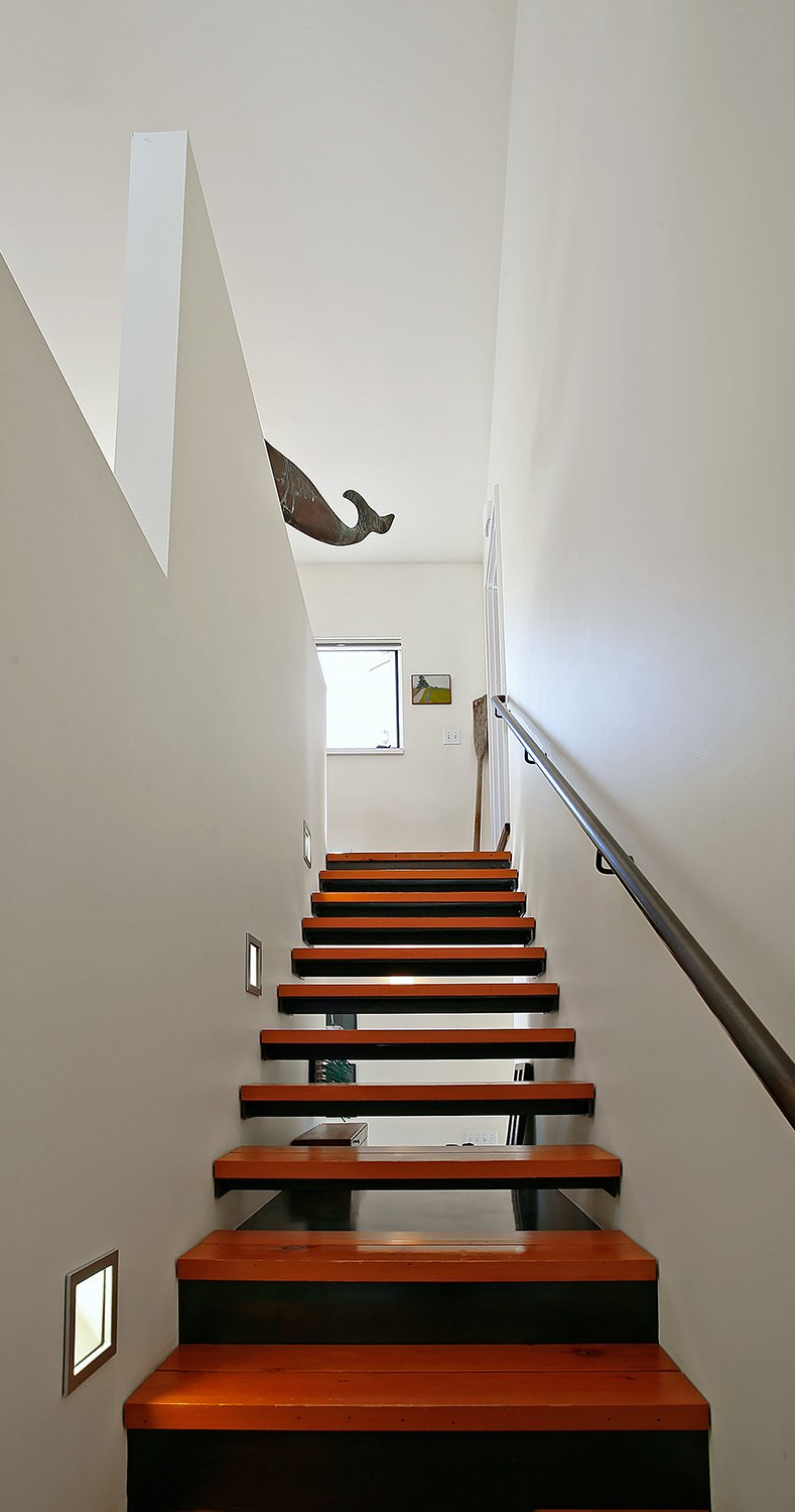Staircase, Metal Tread, Wood Tread, and Metal Railing  House for a Mother & Daughter by Robert Hutchison Architecture