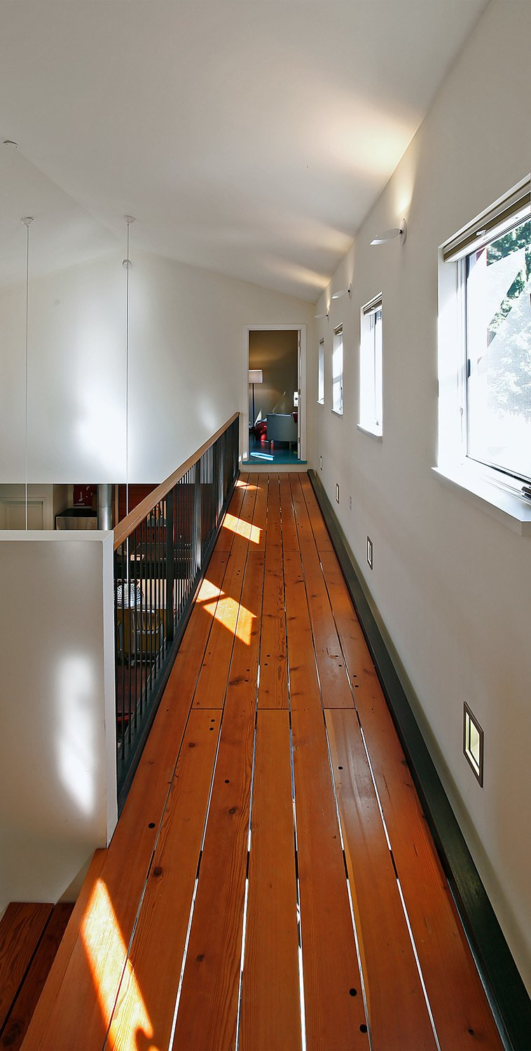Staircase, Wood Tread, and Metal Tread  House for a Mother & Daughter by Robert Hutchison Architecture