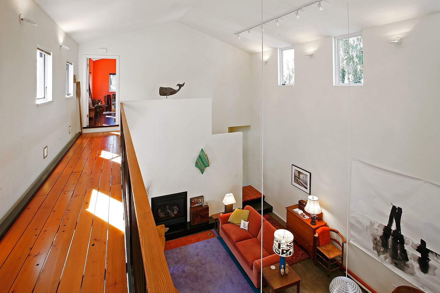 Hallway and Medium Hardwood Floor  House for a Mother & Daughter by Robert Hutchison Architecture