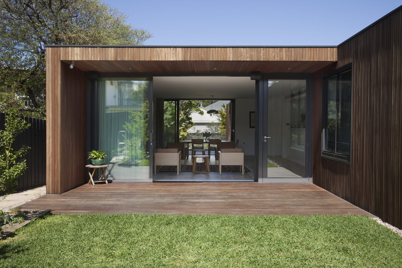Outdoor, Small Patio, Porch, Deck, Wood Patio, Porch, Deck, Grass, and Back Yard  Photo 3 of 6 in A Timber-Clad Home in Australia Is a Striking Place to Grow Old In