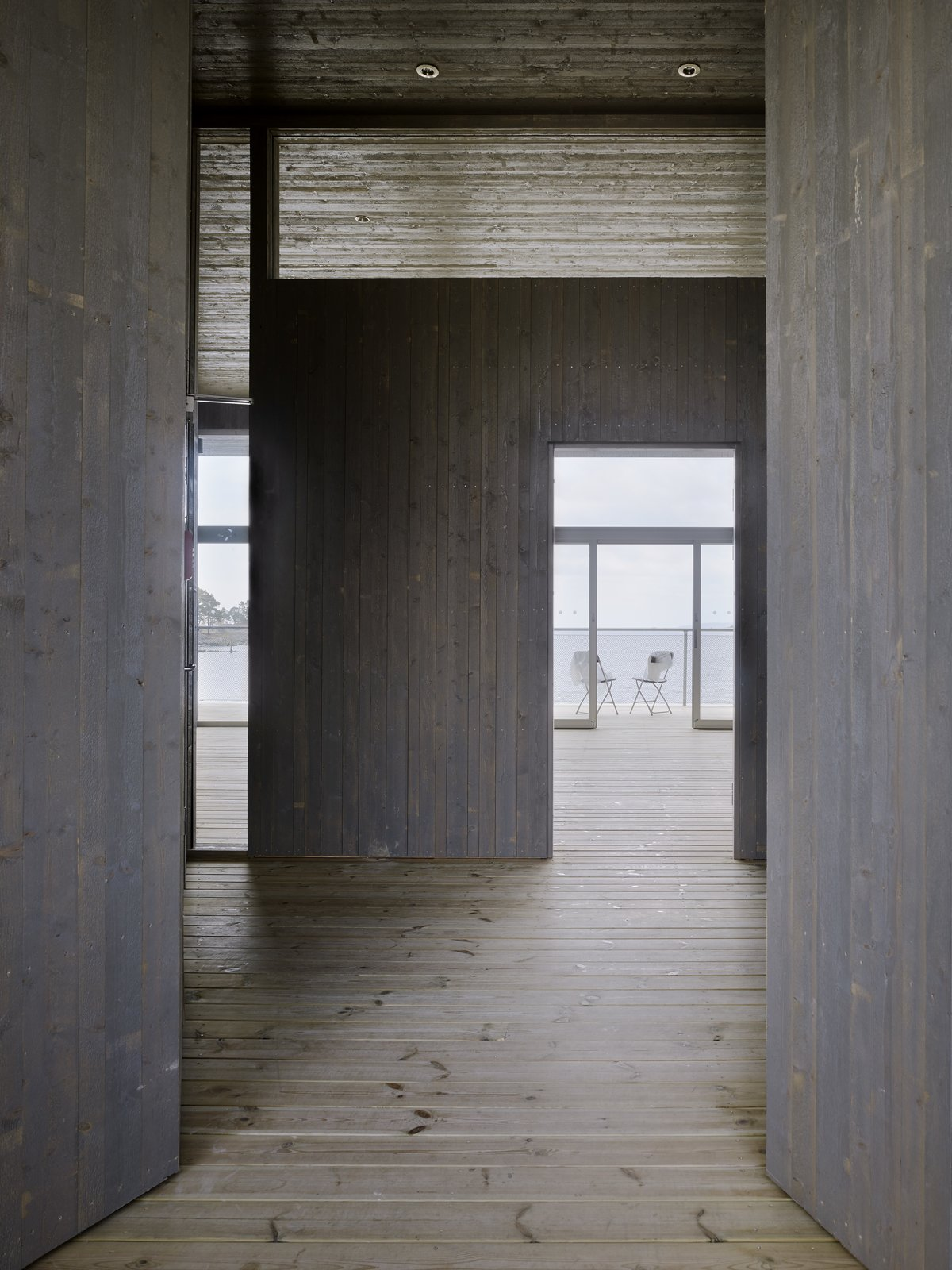 Hallway and Light Hardwood Floor  Photo 5 of 6 in A Swedish Coastal Town Commissions an Otherworldly Bathhouse