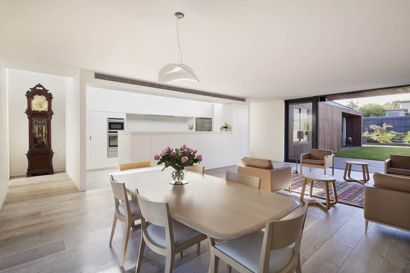 Dining Room, Table, Pendant Lighting, Chair, and Light Hardwood Floor  Photo 2 of 6 in A Timber-Clad Home in Australia Is a Striking Place to Grow Old In